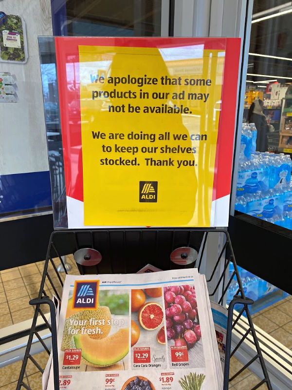 ALDI sign apologizing that some products might not be available. ALDI restocking as fast as they can.