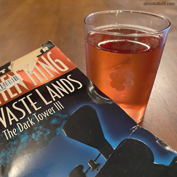 The Dark Tower book and glass of bubbly rose from ALDI