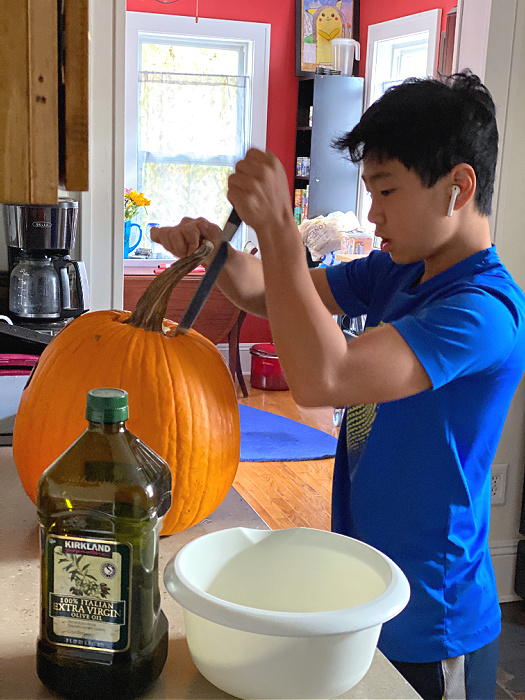 Middle School Guy carving his pumpkin from ALDI