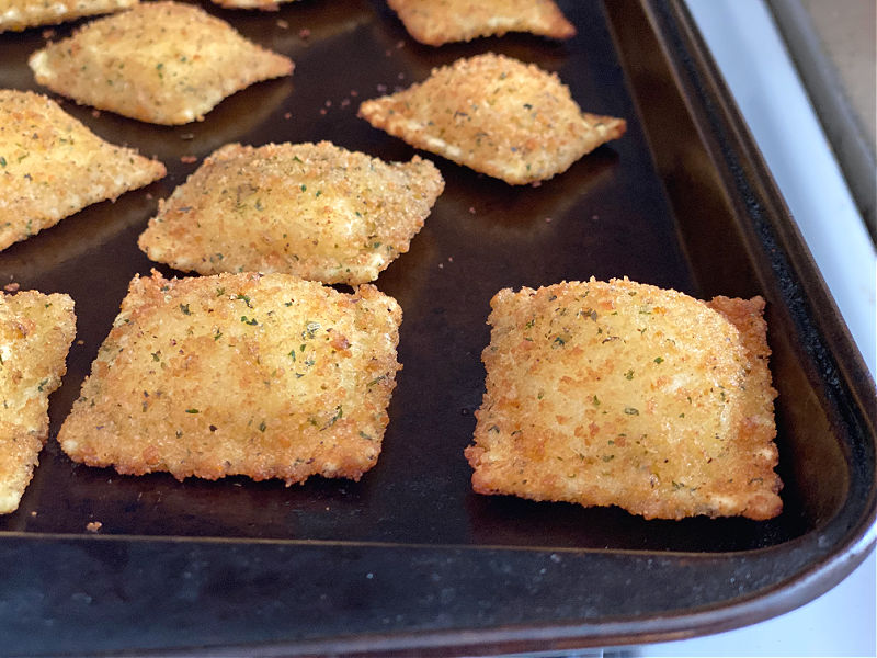 toasted ravioli on cookie sheet