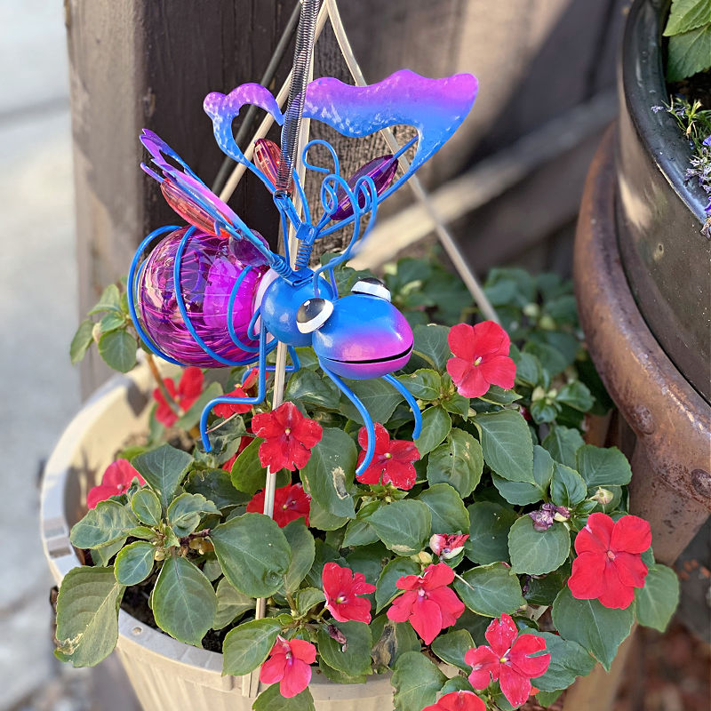 decorative blue and purple bug in a hanging basket
